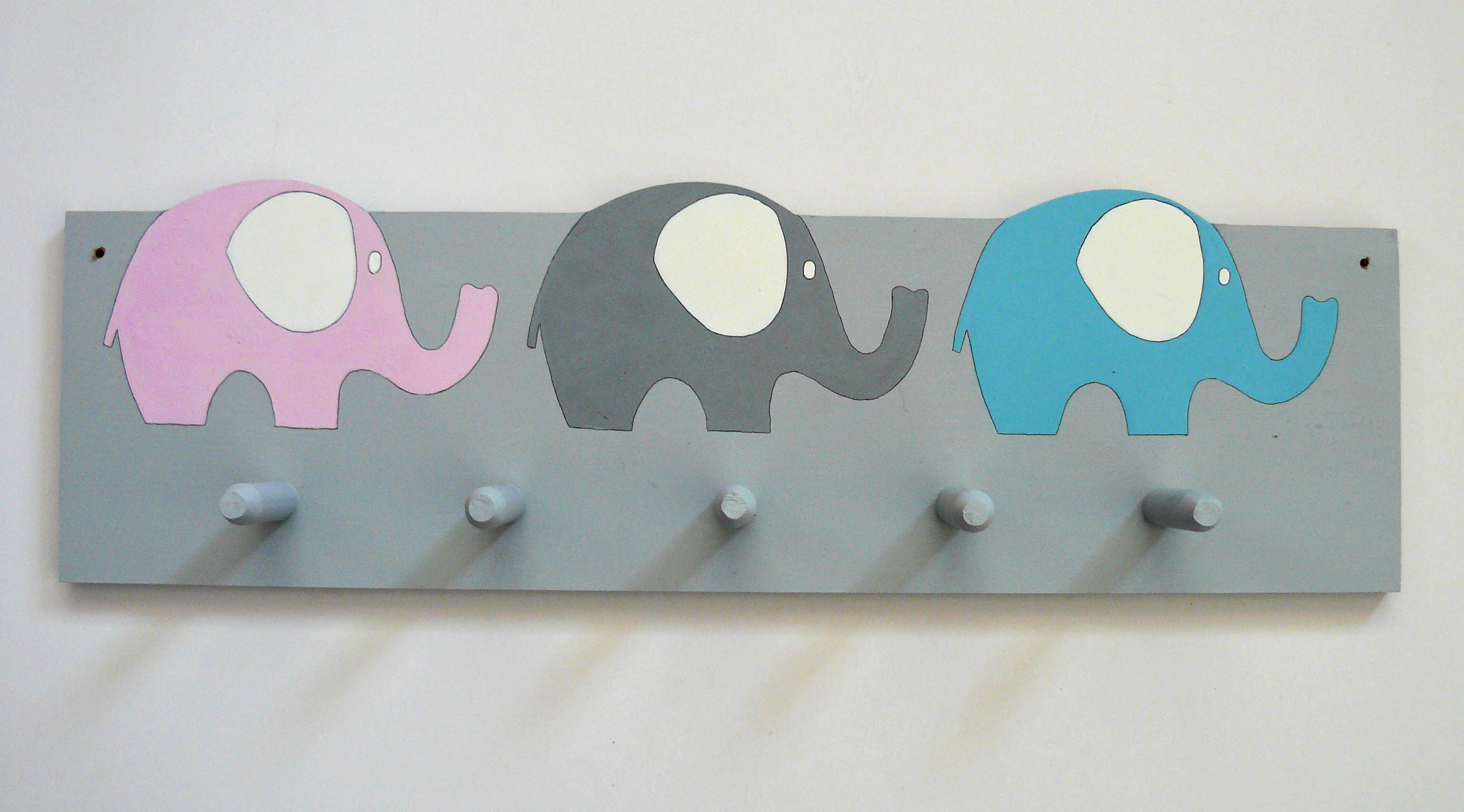Ellies on grey coatrack