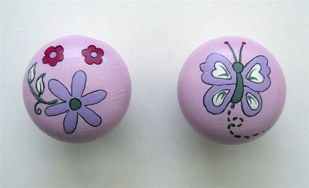 Pink doorknob with flower and butterfly