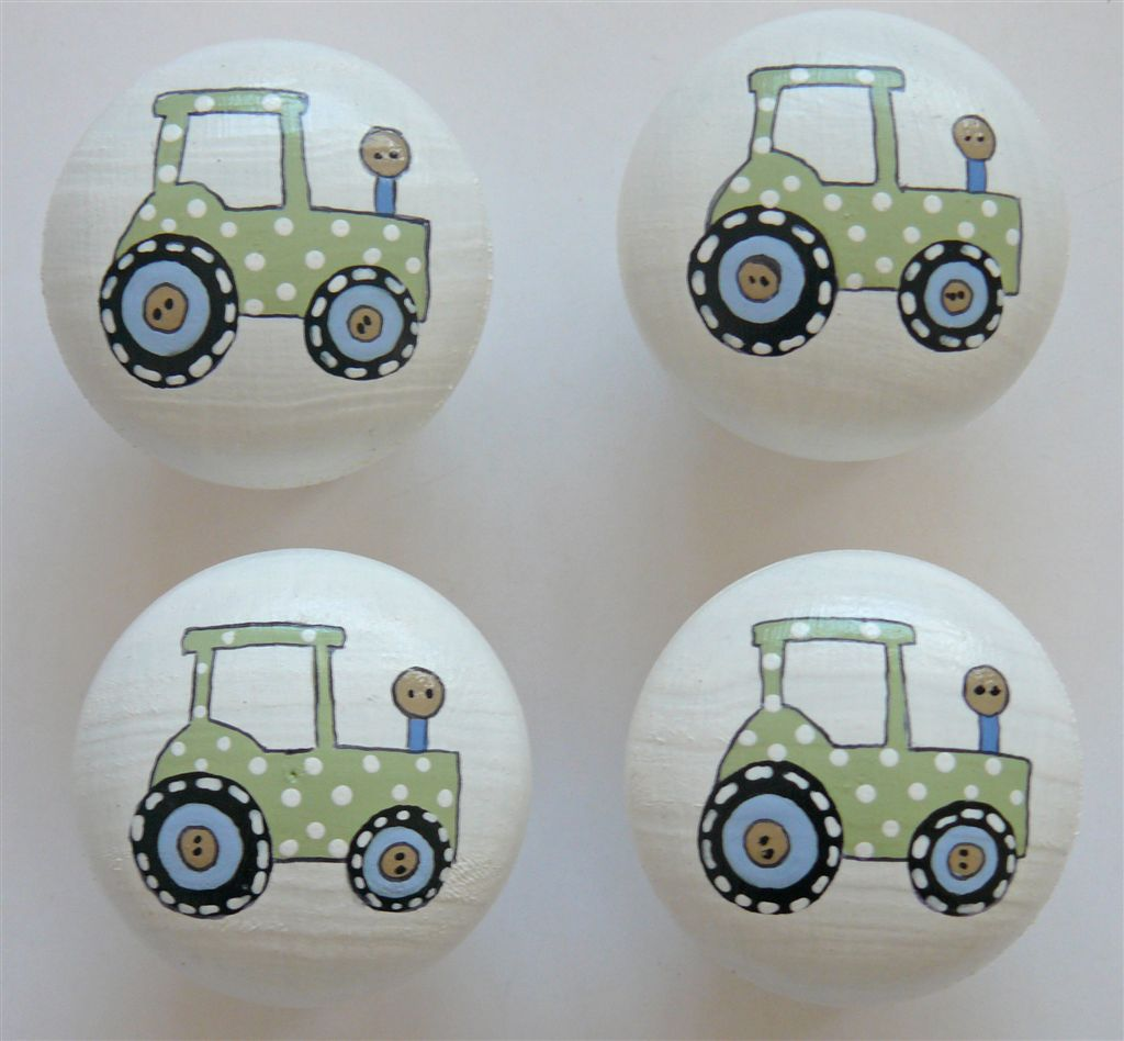 White doorknob with light green tractor