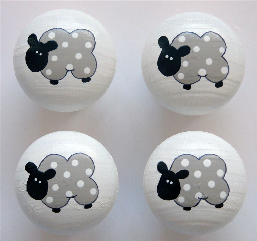 White doorknob with mocha sheep