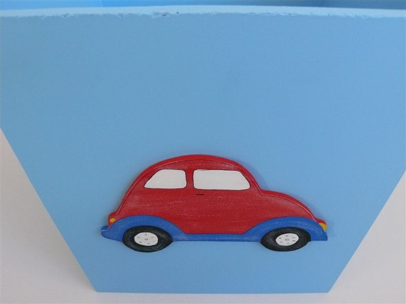 Blue dustbin with red car