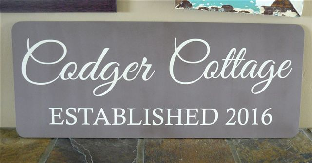 The Codger Cottage plaque