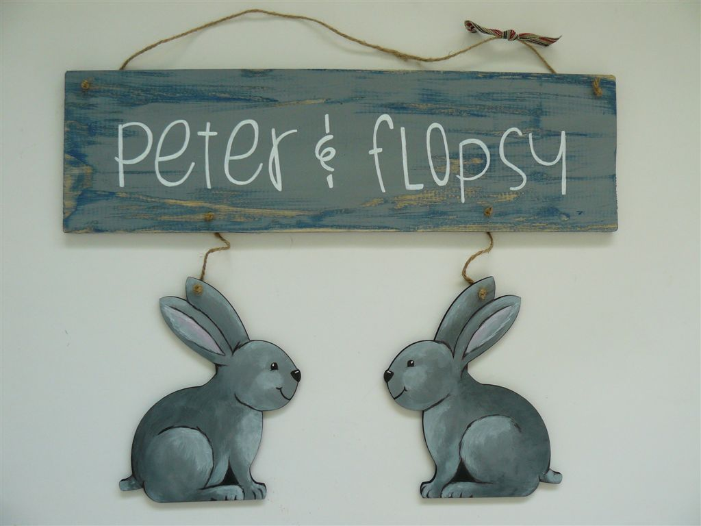 Rustic plaque with two bunnies
