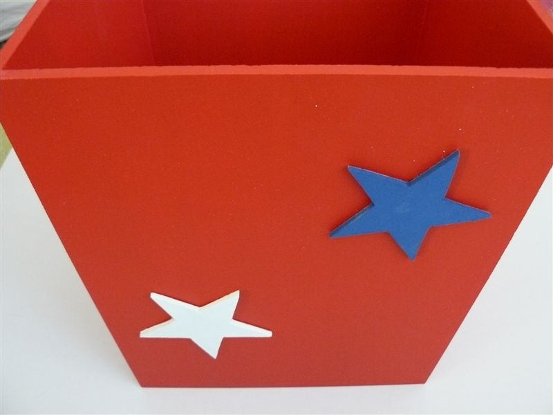Red dustbin with stars